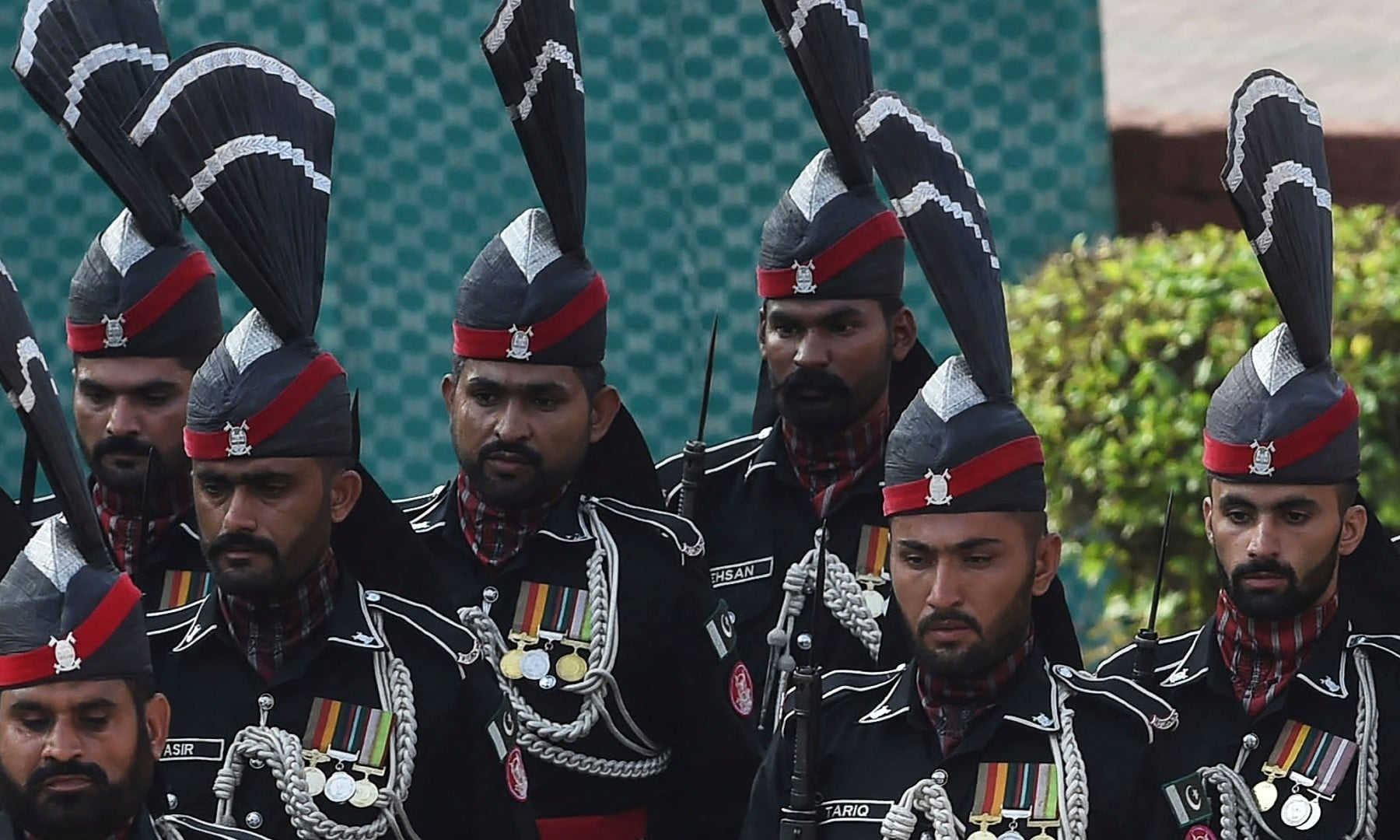 Pakistan's Rangers march past the tomb of national poet Allama Mohammad Iqbal during Independence Day celebrations in Lahore on August 14. — AFP