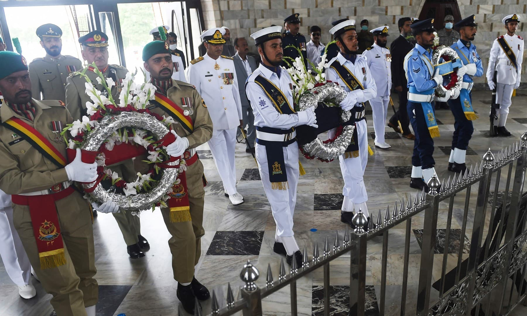 (From L) Pakistan's Army, Navy and Air Force soldiers offer wreaths at  Quaid-i-Azam's mausoleum during Independence Day celebrations in Karachi on August 14. — AFP