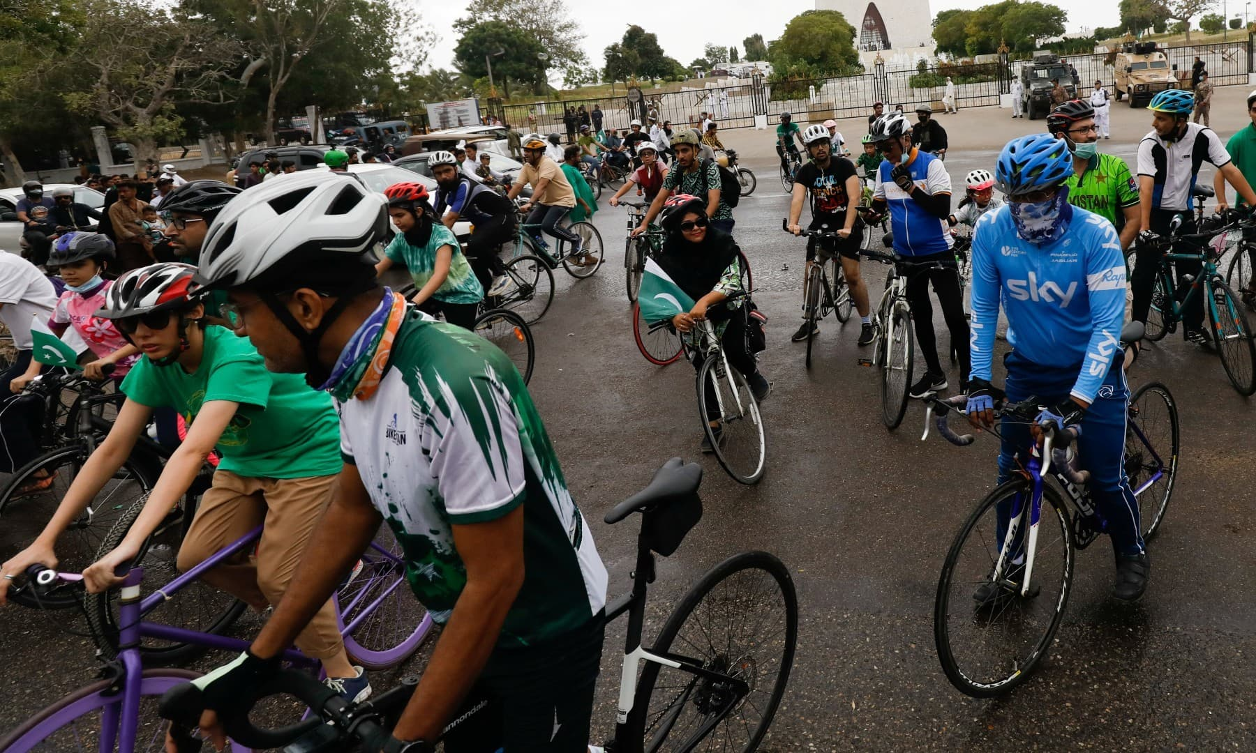 Cyclists pause during the celebration of Independence Day amid the coronavirus pandemic, in Karachi on August 14. — Reuters