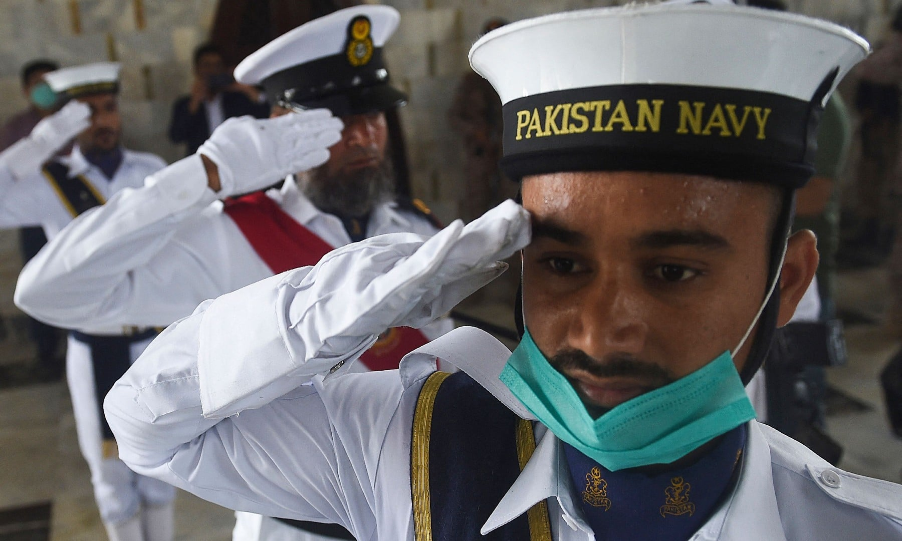Pakistani Naval soldiers salute at the mausoleum of Pakistan's founding father Muhammad Ali Jinnah during Independence Day celebrations in Karachi on August 14. — AFP