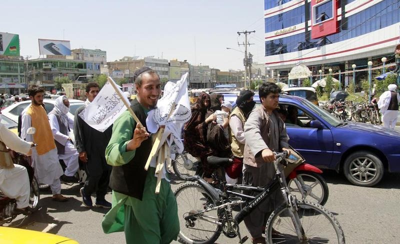 A man sells Taliban flags in Herat province, west of Kabul, Afghanistan, on Saturday, Aug 14, 2021. — AP