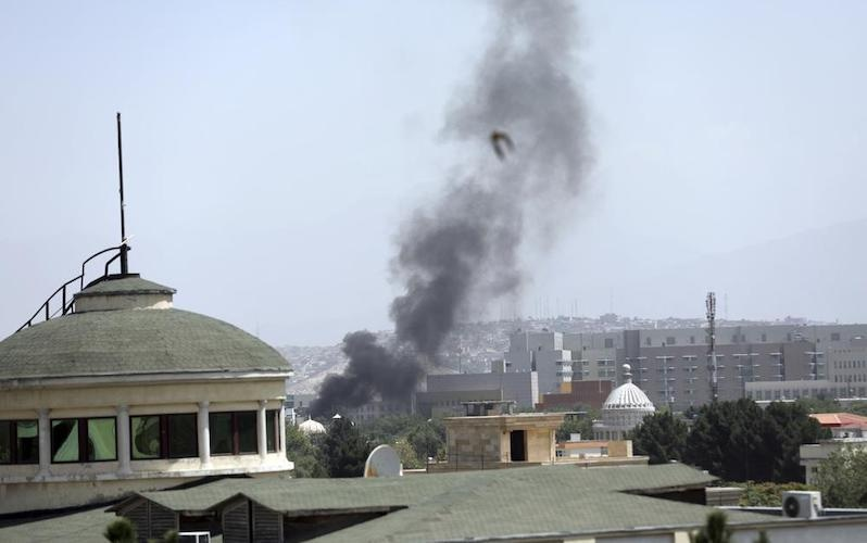 Smoke rises next to the US Embassy in Kabul, Afghanistan on Sunday, Aug. 15, 2021. Taliban fighters entered the Afghan capital on Sunday, further tightening their grip on the country as panicked workers fled government offices and helicopters landed at the embassy. Wisps of smoke could be seen near the embassy's roof as diplomats urgently destroyed sensitive documents, according to two American military officials. — AP