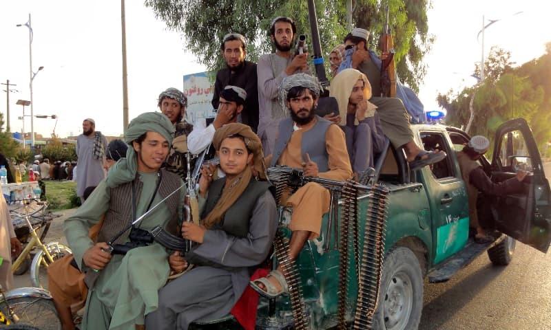 Taliban fighters patrol inside a city of Kandahar province, southwest of Afghanistan, Sunday, Aug 15. — AP