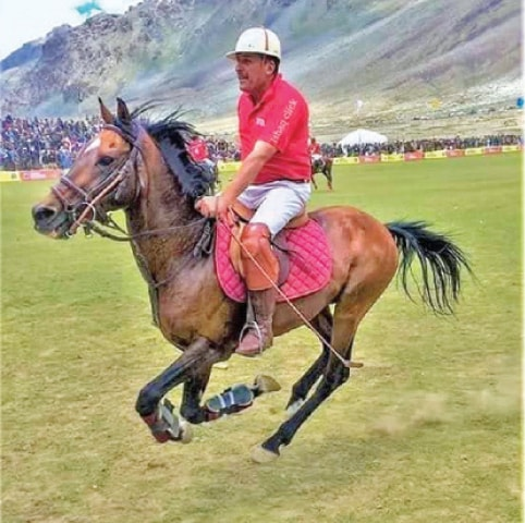 Shahzada Sikandarul Mulk in action during a polo match in Shandur. — File photo