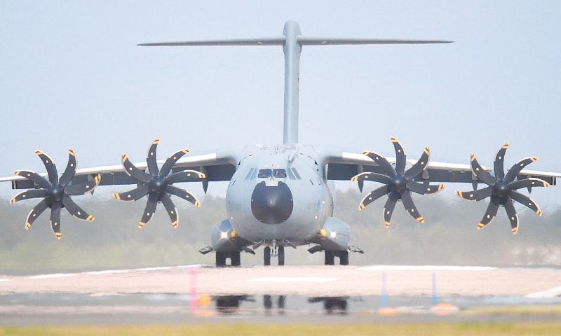 HANOVER: A transport aircraft of Bundeswehr, the German air force, taxis across the runway at an air base. The Bundeswehr plans to begin evacuating German citizens from Kabul on Monday.—AP