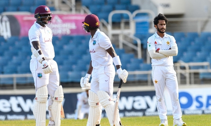 Asif Ali (R) of Pakistan looks on as Jayden Seales (L) of the West Indies celebrate during day 4 of the 1st Test between West Indies and Pakistan at Sabina Park on August 15. — AFP