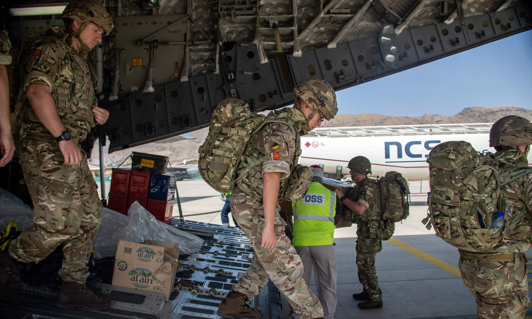 A handout picture taken and released by the British Ministry of Defence on August 15, 2021, shows members of the British Army, from 16 Air Assault Brigade, as they disembark from an RAF Voyager aircraft after landing in Kabul, Afghanistan, to assist in evacuating British nationals and entitled persons as part of Operation PITTING. — AFP