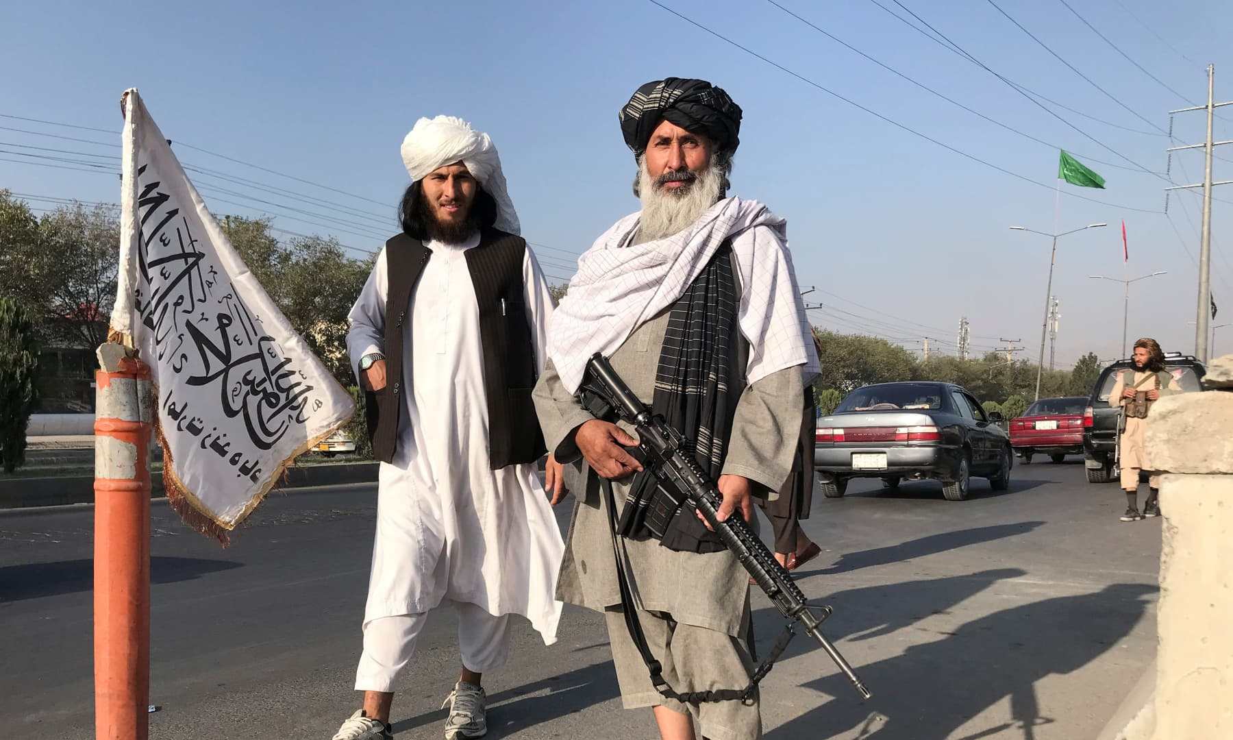 Taliban fighters stand outside the Interior Ministry in Kabul, Afghanistan on August 16, 2021. — Reuters