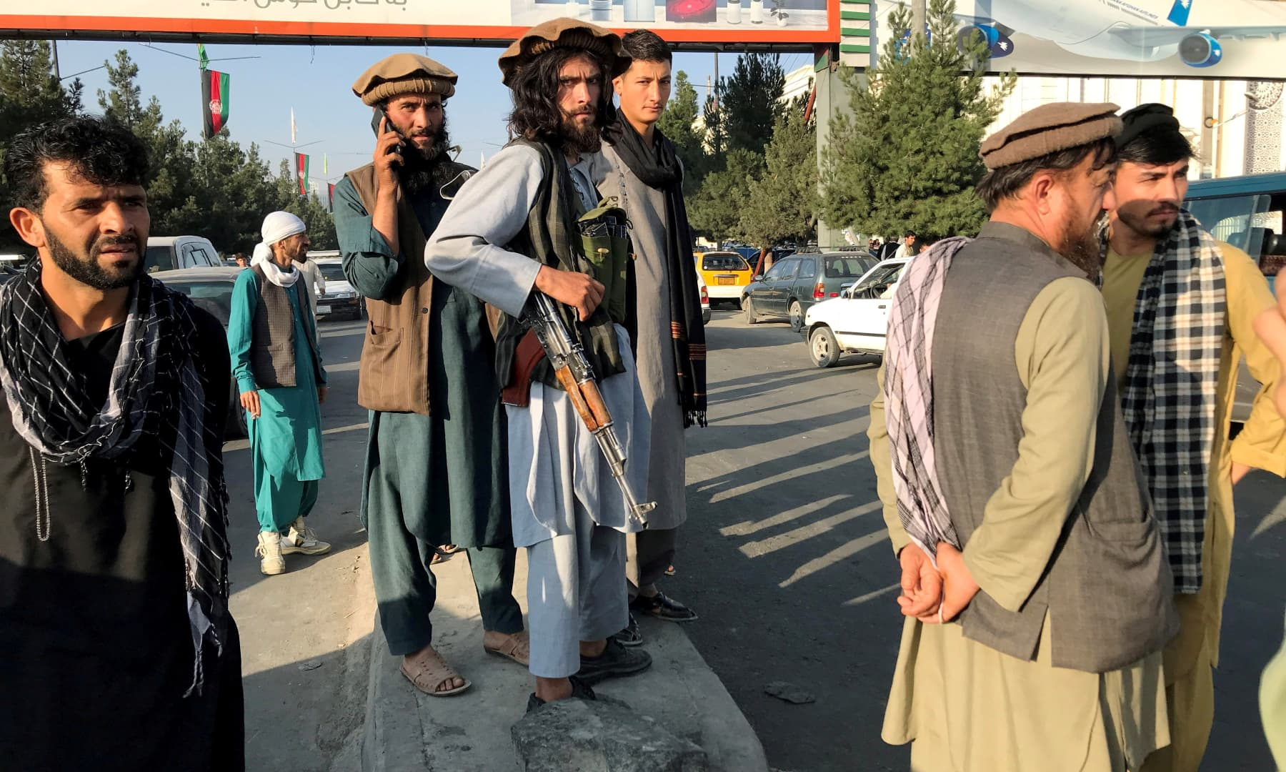 A member of Taliban (C) stands outside Hamid Karzai International Airport in Kabul, Afghanistan, on August 16, 2021. — Reuters