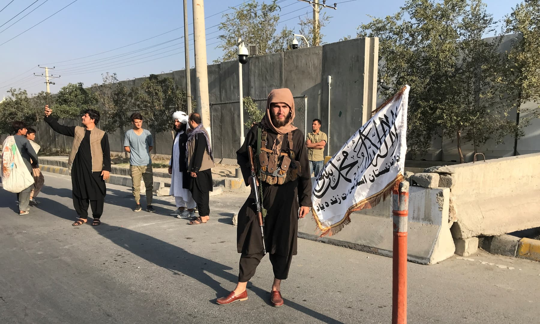 A member of Taliban stands outside the Interior Ministry in Kabul, Afghanistan on August 16, 2021. — Reuters