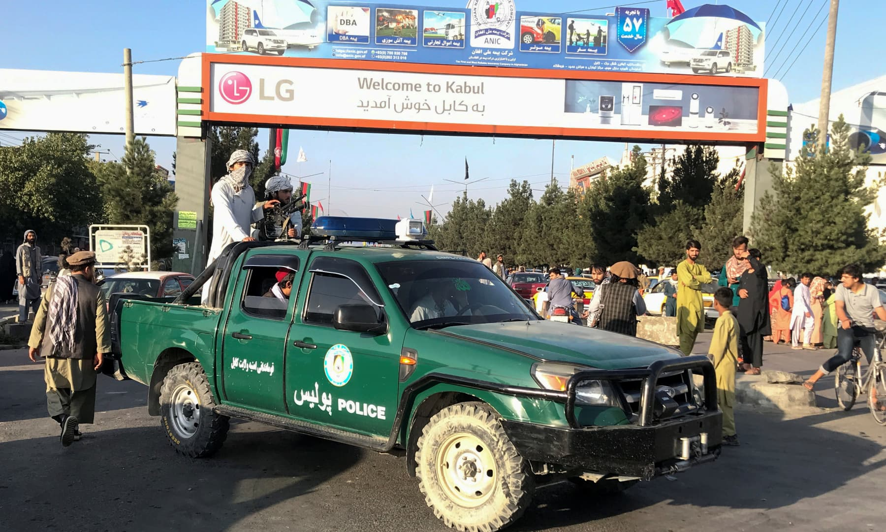 Taliban fighters ride on a police vehicle outside Hamid Karzai International Airport in Kabul, Afghanistan on August 16, 2021. — Reuters