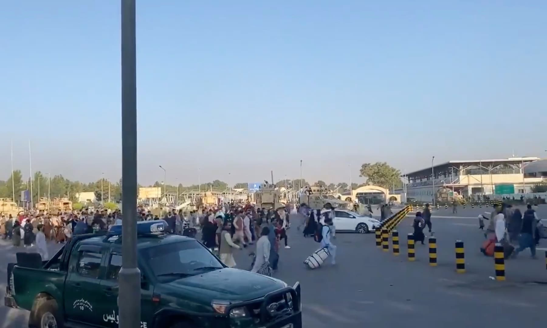 A horde of people run towards the Kabul Airport Terminal after Taliban insurgents took control of the presidential palace in Kabul, Afghanistan on August 16, 2021. — Reuters
