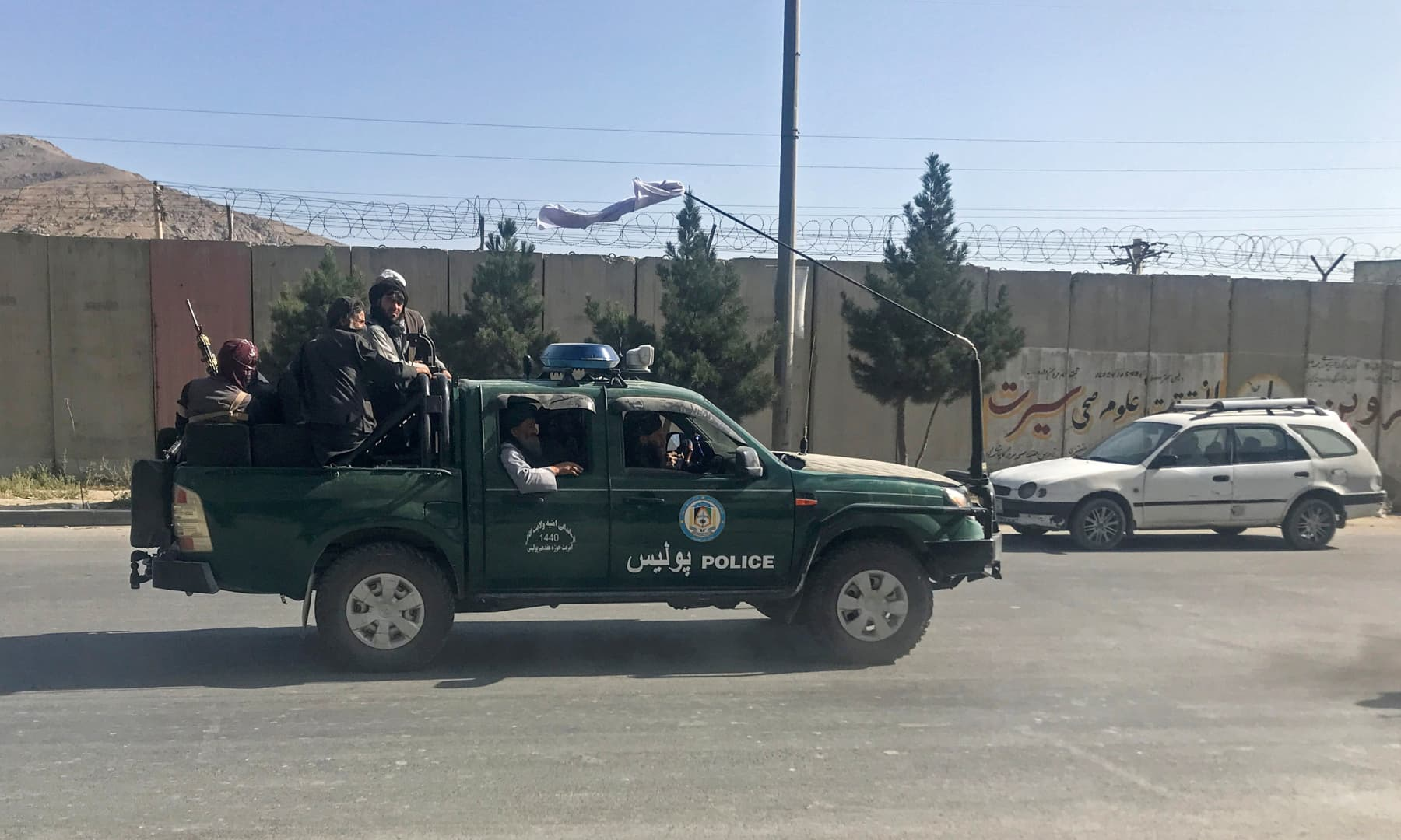 Taliban fighters ride on a police vehicle in Kabul, Afghanistan on August 16, 2021. — Reuters