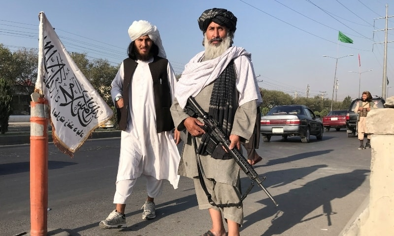 Taliban fighters stand outside the Interior Ministry in Kabul on August 16. — Reuters