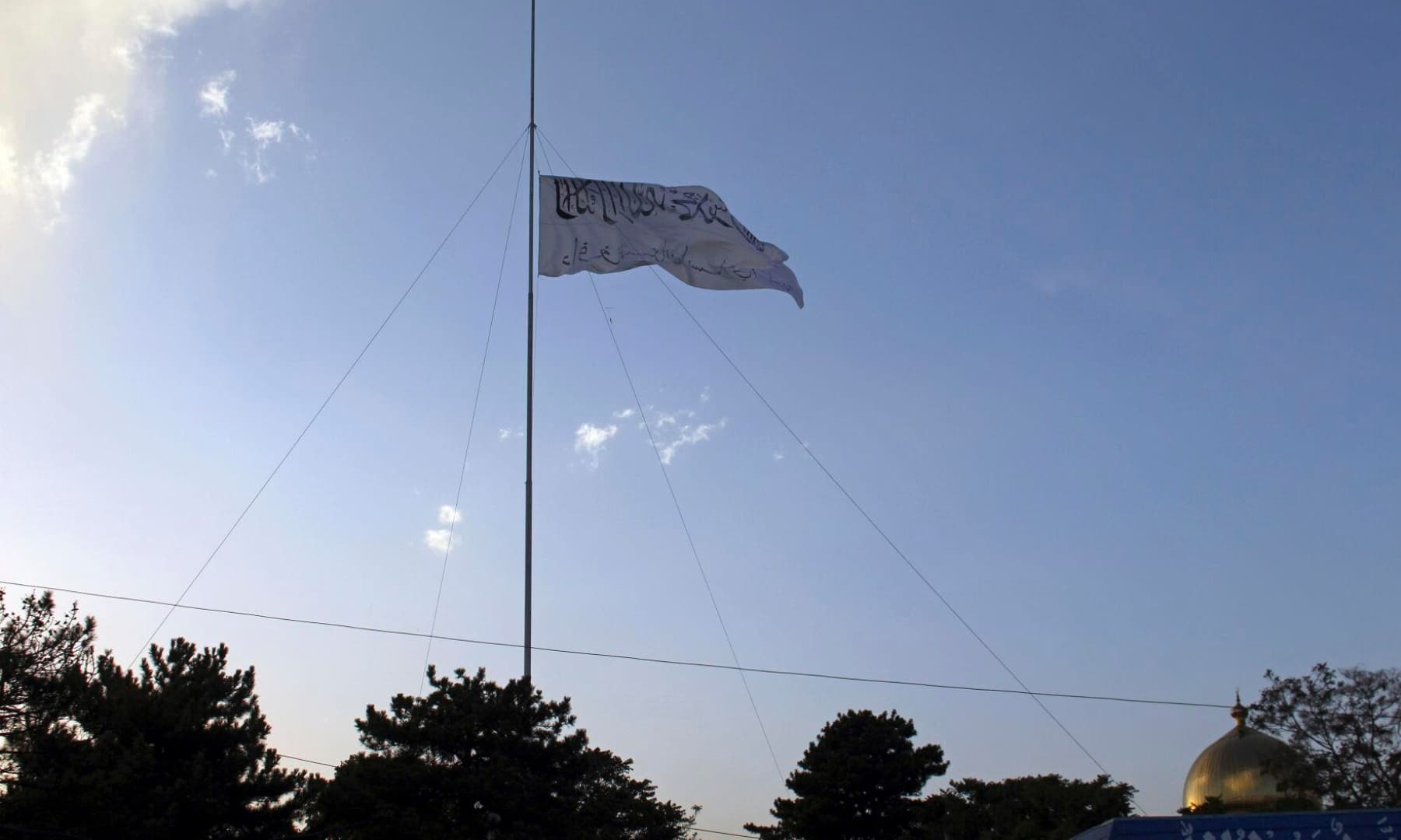 The Taliban flag flies at the Ghazni provincial governor's house, in Ghazni, southeastern Afghanistan on August 15, 2021. — AP