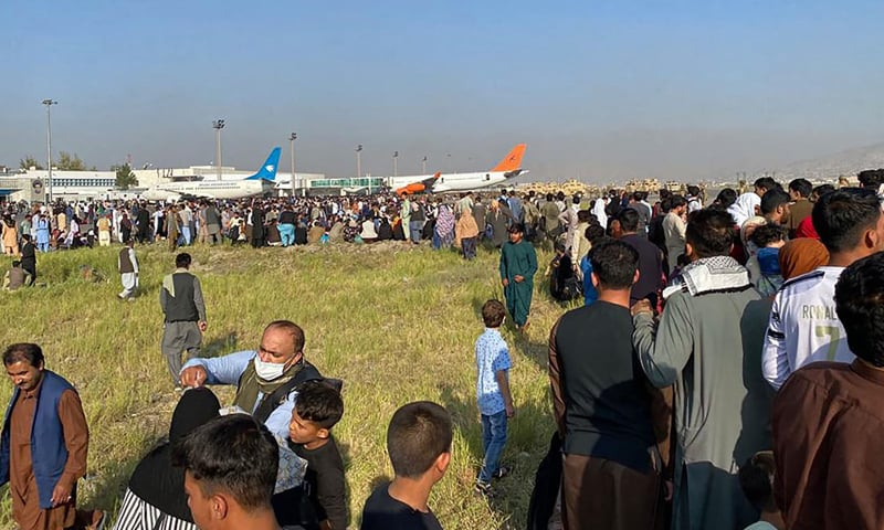 Afghan passengers crowd at the airport as they wait to leave from Kabul, Afghanistan on August 16, 2021. — AFP