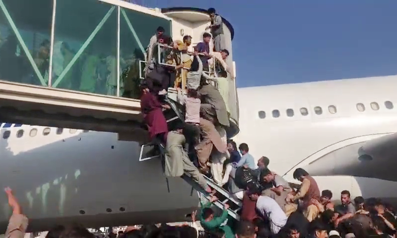 Scenes from Kabul airport show hundreds of Afghans desperate to leave the country on Monday. — Screengrab