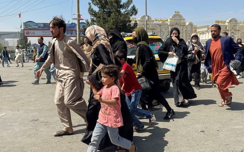 People try to get into Hamid Karzai International Airport in Kabul, Afghanistan on August 16, 2021. — Reuters