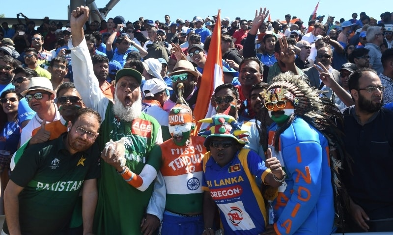 In this file photo taken on June 28, 2019 Pakistan (L) and Indian super fans cheer during the 2019 Cricket World Cup group stage match between West Indies and India at Old Trafford in Manchester. — AFP