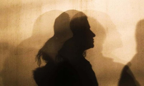 A woman's silhouette  is seen in this file photo. — AP