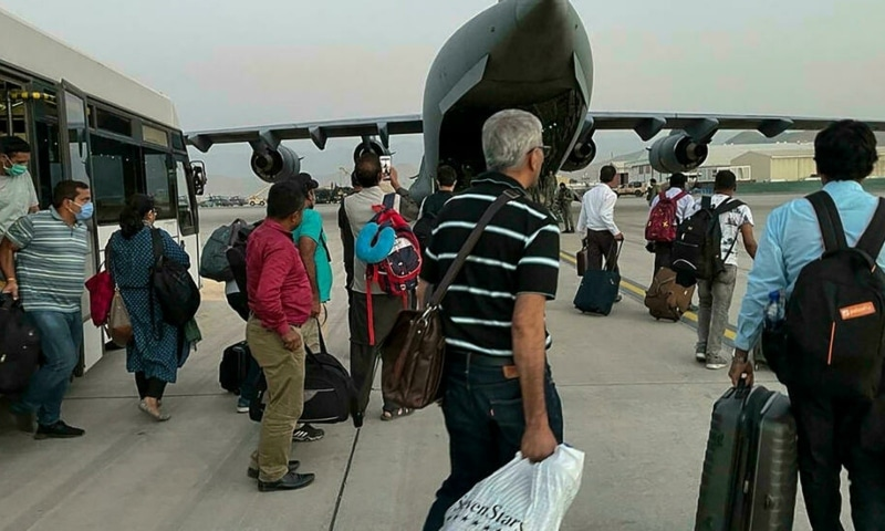 Indian nationals prepare to board an Indian military aircraft to be evacuated after the Taliban takeover of Afghanistan. — AFP