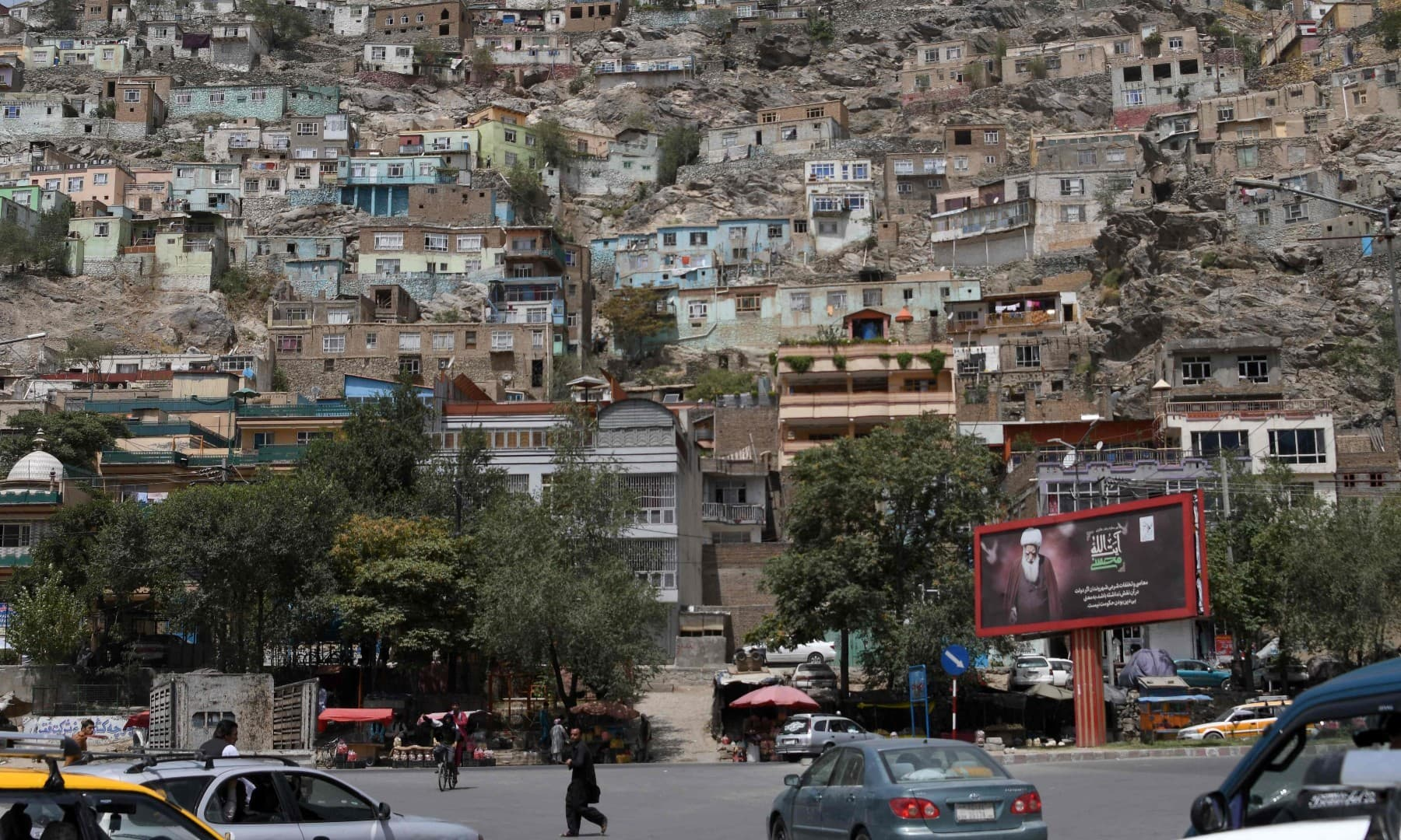 Commuters make their way along a road in Kabul on August 18 following the Taliban stunning takeover of Afghanistan. — AFP