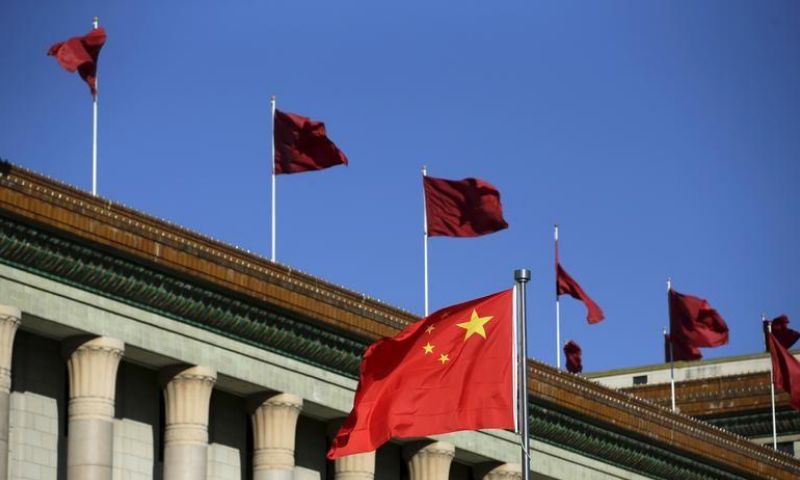 Chinese flag waves in front of the Great Hall of the People in Beijing, China in this file photo. — Reuters?File