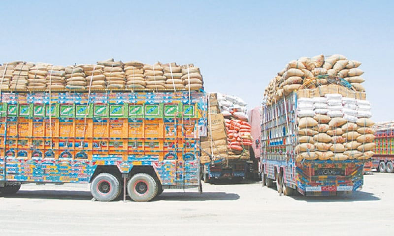 Trucks loaded with supplies wait to cross into Afghanistan at the Friendship Gate crossing point in Chaman last week.—Reuters