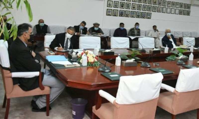 In this file photo, Planning Minister Asad Umar presides over a meeting of the Cabinet Committee on Energy. — APP