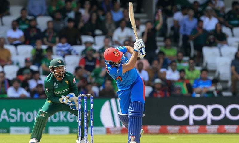 In this file photo, Afghanistan's Asghar Afghan (R) is watched by Pakistan's Sarfaraz Ahmed as he hits a six during the 2019 Cricket World Cup group stage match between Pakistan and Afghanistan at Headingley in Leeds on June 29. — AFP