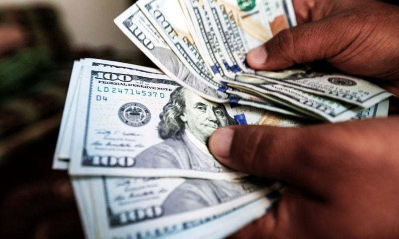 The dollar gained 77 paisa against the rupee on Tuesday to close at Rs165.20. — AFP/File