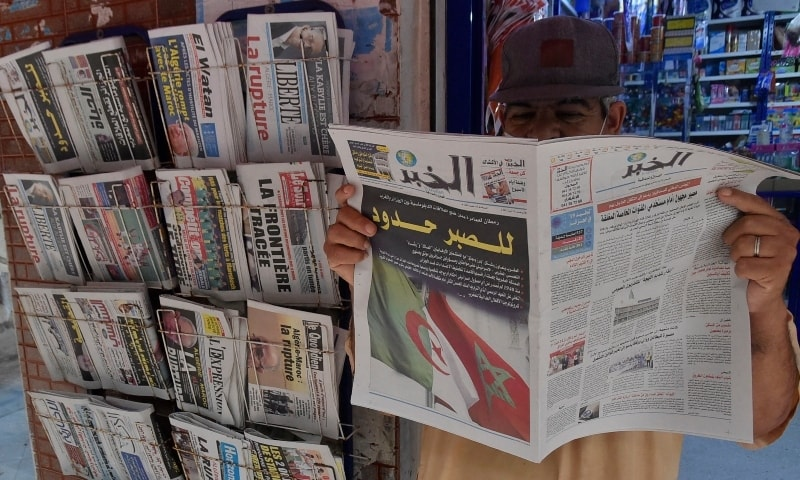 An Algeria man holds today's newspaper in the capital Algiers, on August 25. — AFP