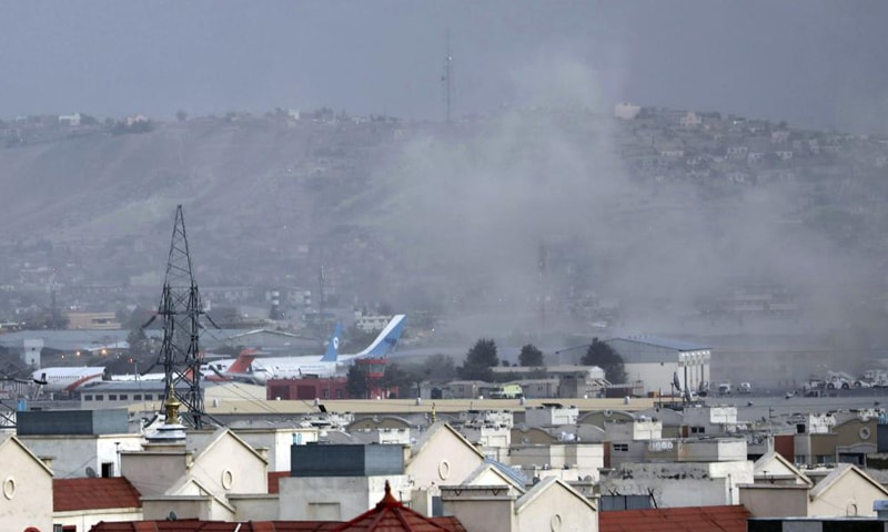 Smoke rises from a deadly explosion outside the airport in Kabul, Afghanistan on Thursday. — AP