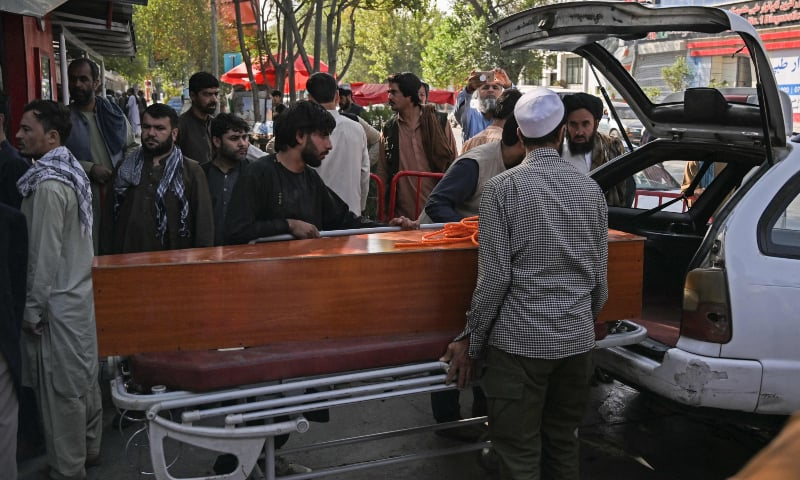 Relatives load in a car the coffin of a victim of the August 26 twin suicide bombs, which killed scores of people including 13 US troops outside Kabul airport, at a hospital in Kabul, Afghanistan on August 27. — AFP