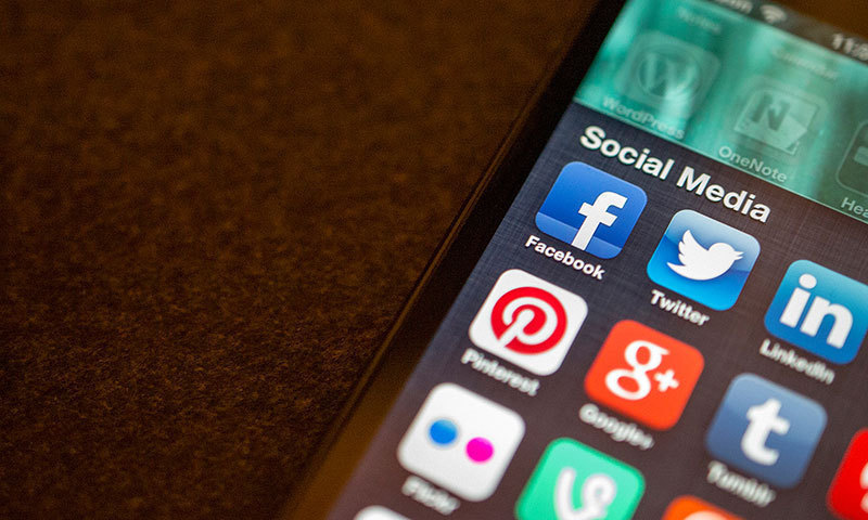 This file photo shows icons of social media apps on a mobile phone. — AFP/File