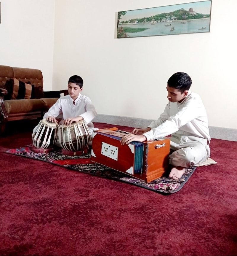 Muneeb (right) on the harmonium and Mubeen (left) on the Tabla