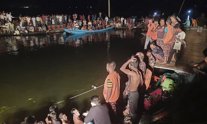 People watch rescue work after a passenger boat sank after a collision in a large pond in Brahmanbaria district, Bangladesh on Friday. — AP