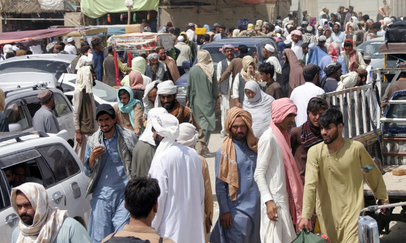 People arriving from Afghanistan gather at the Friendship Gate crossing point in the Pakistan-Afghanistan border town of Chaman on Aug 27. — Reuters/File