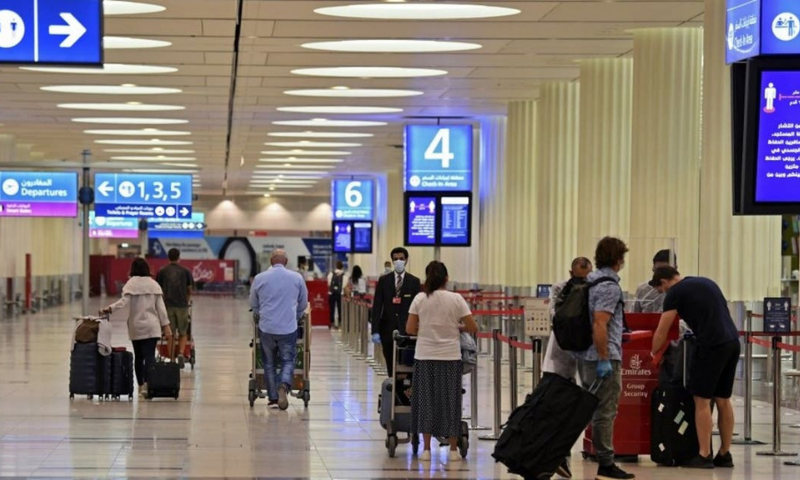 Passengers are seen at the Dubai International Airport after resumption of some Emirates fights. — AFP/File