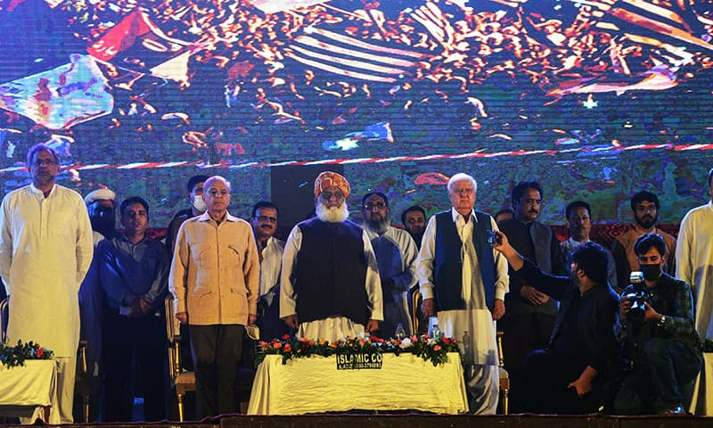 PML-N President Shehbaz Sharif, JUI-F chief Maulana Fazlur Rehman (C), and other PDM leaders stand during an anti-government rally in Karachi on Sunday. — AFP