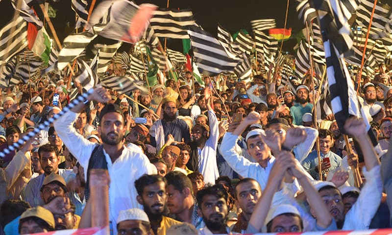 PDM supporters shout slogans during an anti-government rally in Karachi on August 29. — AFP