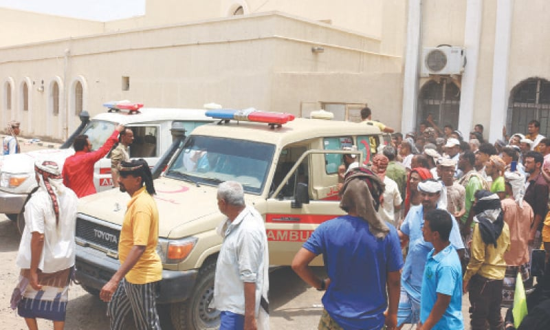 PEOPLE gather as ambulances transport casualties of the attack on Al-Anad airbase to the Ibn Khaldun hospital in Yemen's province of Lahij on Sunday.—AFP