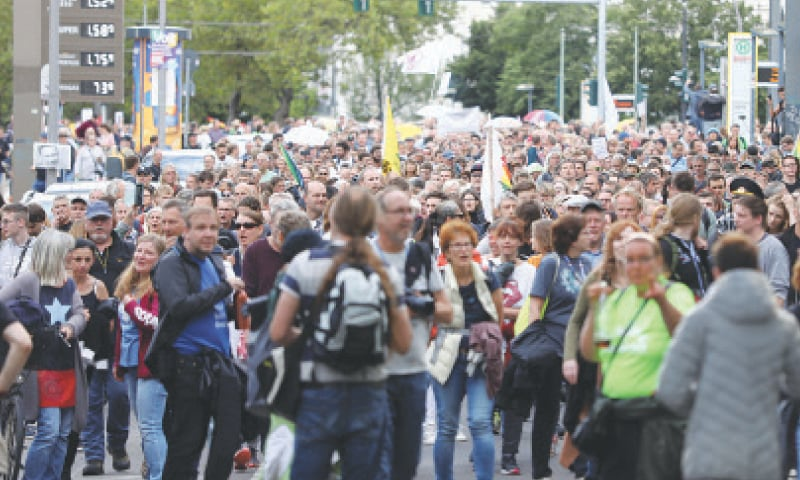 Demonstrators attend a protest against government measures to curb the spread of the coronavirus disease in Berlin on Sunday.—Reuters
