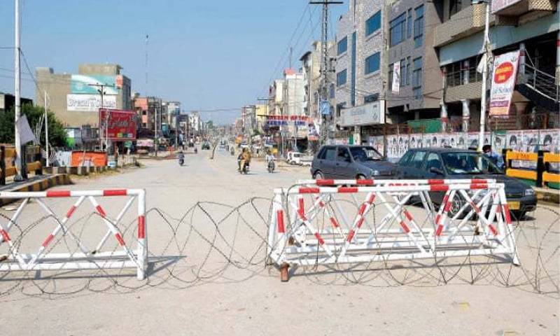 This file photo shows the sealed entrance of Ghauri Town in Islamabad during a lockdown. — Photo by Tanveer Shahzad/File