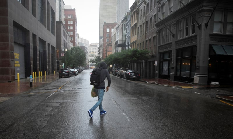 A man walks in the rain as Hurricane Ida makes landfall in Louisiana, in New Orleans, Louisiana, US on August 29. — Reuters