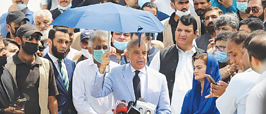 PML-N president Shehbaz Sharif speaks to reporters on Monday.
