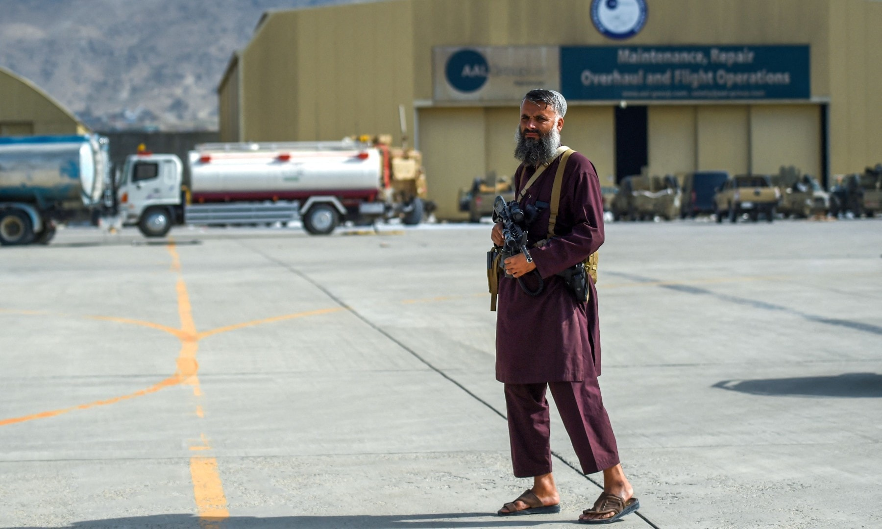 A Taliban fighter stands guard at the airport in Kabul on August 31. — AFP
