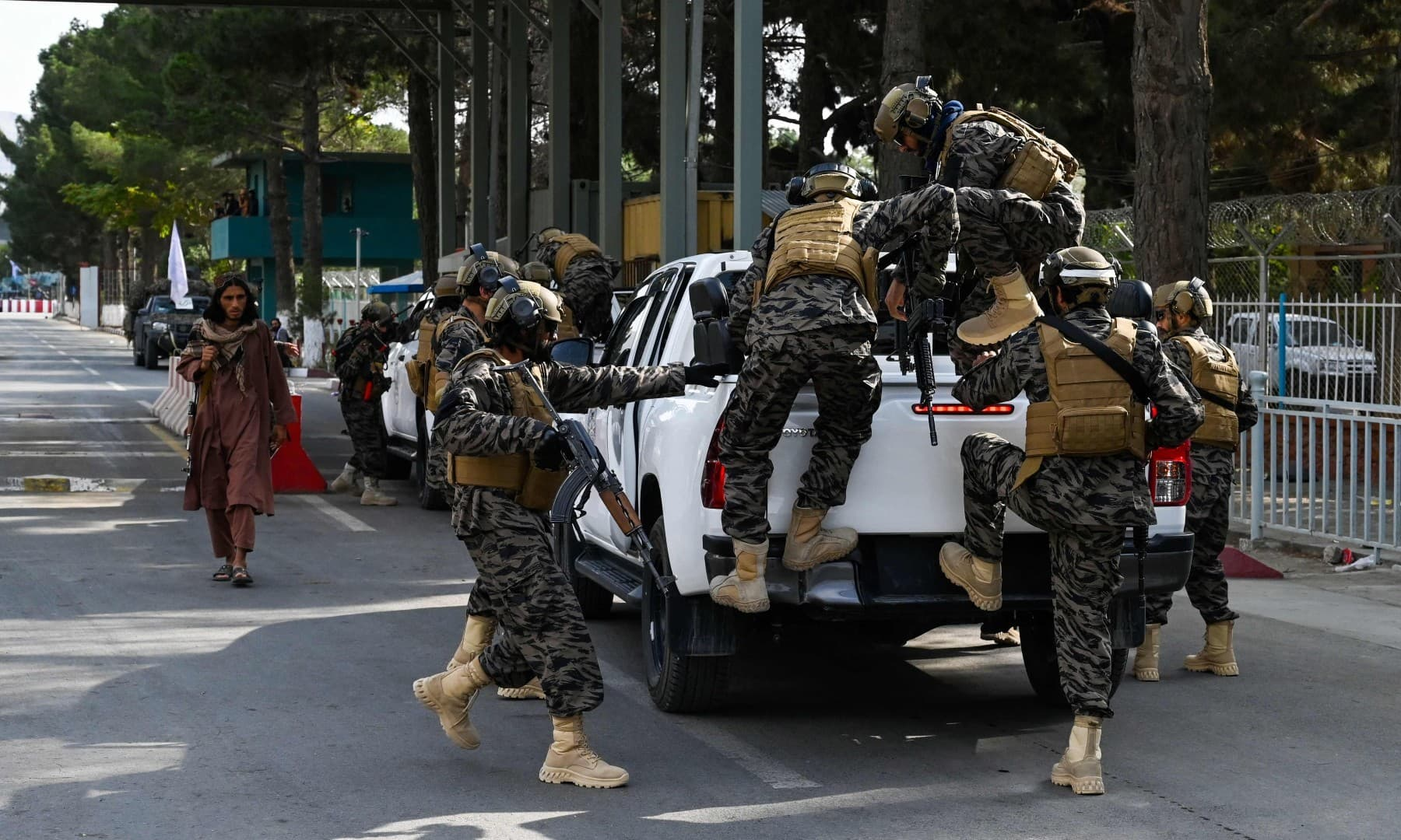Taliban Badri special force fighters arrive at the main entrance gate of the airport in Kabul on August 31. — AFP
