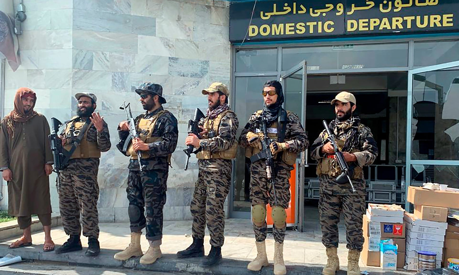 Taliban fighters stand guard inside the Hamid Karzai International Airport after the US withdrawal in Kabul on August 31. — AFP