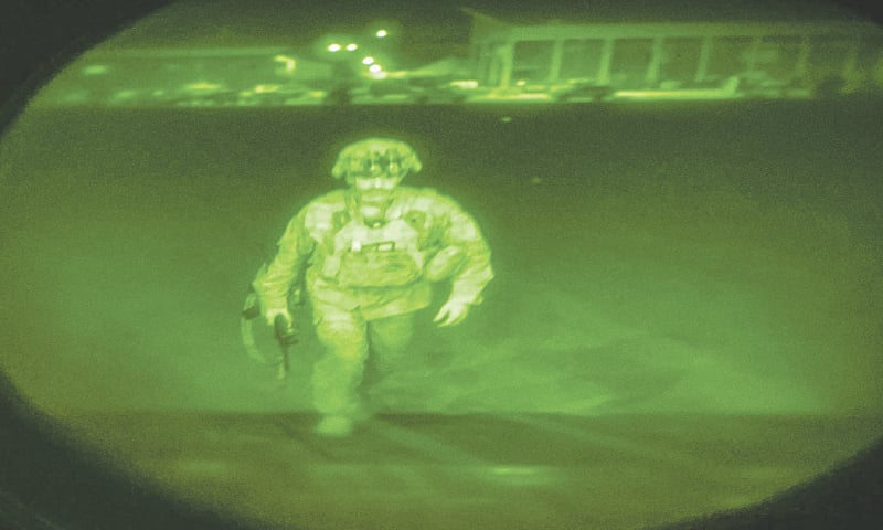 AN image made through night vision scope and provided by the US Army, Maj Gen Chris Donahue, commander of the 82nd Airborne Division, boards a C-17 cargo plane at Kabul airport on Monday night. He was the last American service member to leave Afghanistan.—AP